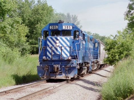 GLC 385 heads north with a freight train near Whitmore Lake, MI  2009  [Nathan Nietering]